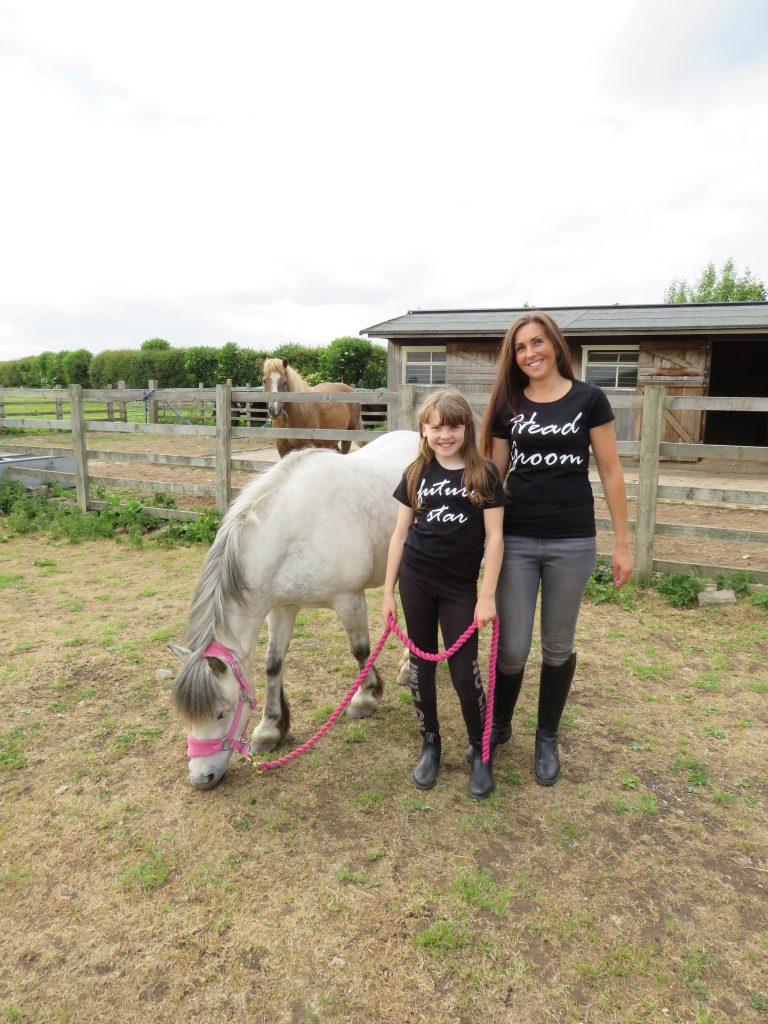 lady, child and pony