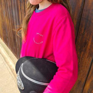 girls wearing pink sweatshirt