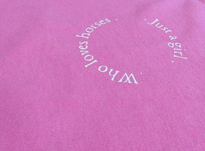 pink sweatshirt with riding logo